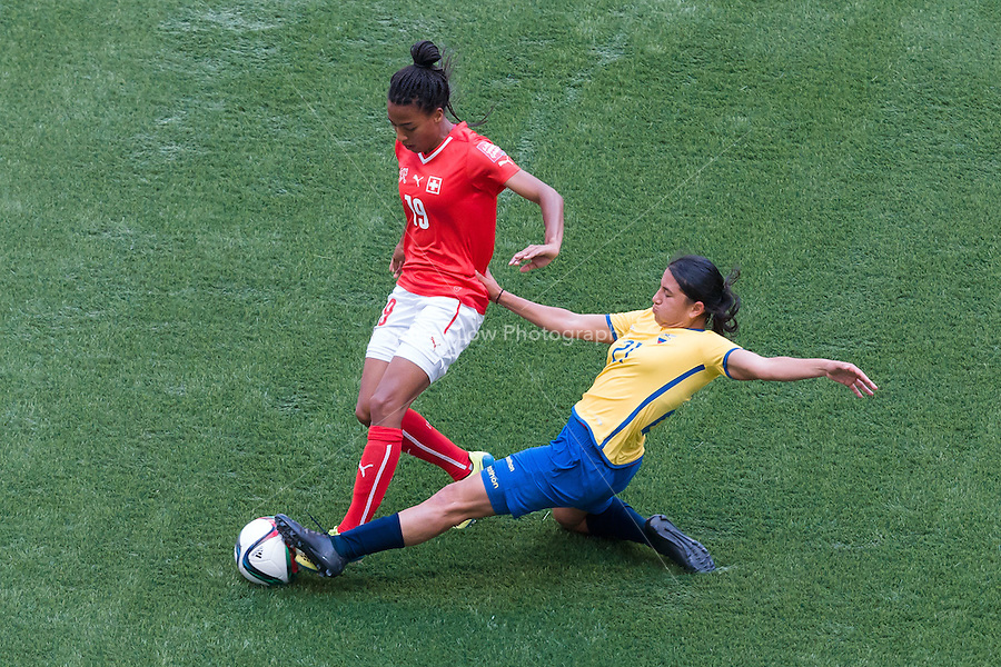 June 12, 2015: Eseosa AIGBOGUN of Switzerland and Mabel VELARDE of Ecuador fight for the ball during a Group C match at the FIFA Women's World Cup Canada 2015 between Switzerland and Ecuador at BC Place Stadium on 12 June 2015 in Vancouver, Canada. Switzerland won 10-1. Sydney Low/AsteriskImages