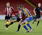 Billy Sharp of Sheffield United tussles with Oliver Lancashire of Shrewsbury Town during the English Football League One match at Bramall Lane, Sheffield. Picture date: November 19th, 2016. Pic Jamie Tyerman/Sportimage