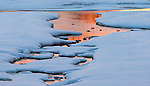 Ducks swim in icy water as the winter sun sets. (DOUG WOJCIK MEDIA)