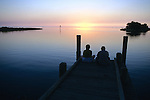 People On Dock At Sunset