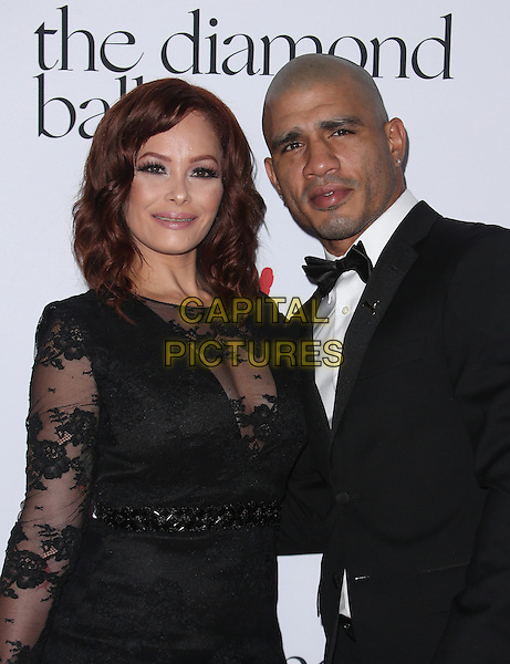Santa Monica, CA - December 10 Melissa Cotto, Miguel Cotto Attending Rihanna and The Clara Lionel Foundation Host 2nd Annual Diamond Ball At The Barker Hanger On December 10, 2015. <br /> CAP/MPI/FS<br /> &copy;FS/MPI/Capital Pictures