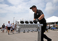 Apr. 26, 2013; Baytown, TX, USA: NHRA crew member for top fuel dragster driver Steve Torrence moves an engine block during qualifying for the Spring Nationals at Royal Purple Raceway. Mandatory Credit: Mark J. Rebilas-