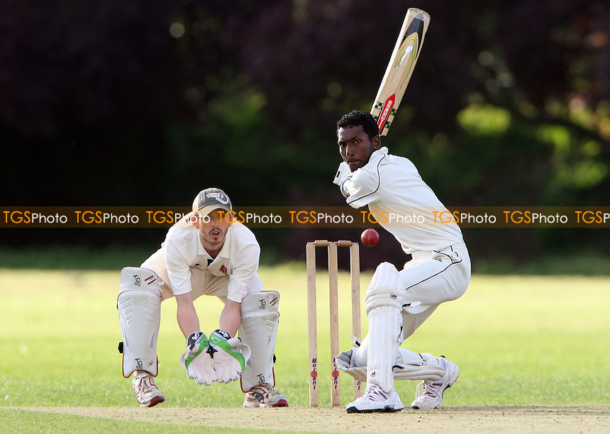 Sree of Rayleigh in batting action - Rainham Cricket Club vs Rayleigh Cricket Club 2nd XI, Essex Club Cricket at Spring Farm Park, Rainham, Essex - 30/06/12 - MANDATORY CREDIT: Rob Newell/TGSPHOTO - Self billing applies where appropriate - 0845 094 6026 - contact@tgsphoto.co.uk - NO UNPAID USE..