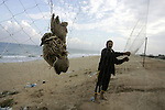 A Palestinian man man tries to catch the migrant quail, where hunted on the beach of Khan Younis, southern Gaza Strip on  Sept. 25, 2011. Palestinians erected hundreds of meters of nets along the coastline in the Gaza Strip to hunt migratory birds, mainly quails, which arrive to the coasts of the Mediterranean in the second half of September of each year. Photo by Abed Rahim Khatib