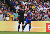 Wilfred Zaha of Crystal Palace gets booked during Crystal Palace vs Brighton & Hove Albion, Premier League Football at Selhurst Park on 14th April 2018