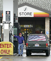 Owen Channel, of Martins Ferry, fills up at a Flying J travel plaza Thursday, Nov. 16, 2006 in Kirkersville, Ohio.<br />