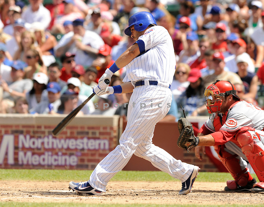 GEOVANY SOTO,  of the Chicago Cubs,  in action  during the Cubs  game against the Cincinnati Reds in Chicago, Illinois on July 4, 2010. The Cincinnati Reds beat the Chicago Cubs b14-3..