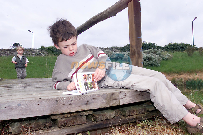 Pictured above at the Launch of the Bridgestone 100 Best Places to Stay in Ireland 2002 and 100 Best restaurants in Ireland 2002 in Ghan House Carlingford, Co Louth. Sam McKenna (6) having a look at where he's going to stay nest.No Repo Fee..Picture Fran Caffrey Newsfile...This Picture is sent to you by:..Newsfile Ltd.The View, Millmount Abbey, Drogheda, Co Louth, Ireland..Tel: +353419871240.Fax: +353419871260.GSM: +353862500958.ISDN: +353419871010.email: pictures@newsfile.ie.www.newsfile.ie