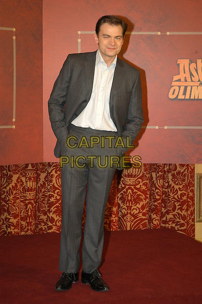 "CLOVIS CORNILLAC.Photocall for ""Asterix aux jeux olympiques"" (Asterix at the Olympic Games), Rome, Italy..January 28th, 2008.full length suit hands in pockets grey gray .CAP/CAV.©Luca Cavallari/Capital Pictures. *** Local Caption *** ."