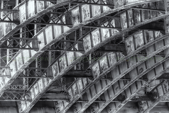 The stone and steel girder arch supports of the Longfellow Bridge, which spans the Charles River from Cambridge to Beacon Hill in Boston, Massachusetts.