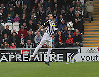 Marc McAusland chesting the ball in the St Mirren v Ross County Scottish Professional Football League Premiership match played at St Mirren Park, Paisley on 3.5.14.