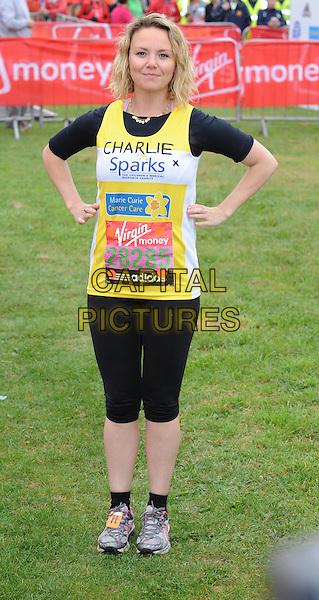 CHARLIE BROOKS.Virgin London Marathon, Blackheath, London, England..April 17th, 2011.full length yellow vest top hands on hips black.CAP/WIZ.© Wizard/Capital Pictures.