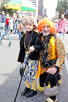 Donald Celentano and his son Wyatt at a parade in Buddy D's honor on January 31, 2010 in New Orleans.<br /> <br /> Thousands of Saints fans wearing dresses paraded from the Louisiana Superdome to the French Quarter to honor a promise made by the late sportscaster and Saints super-fan Buddy Diliberto aka &quot;Buddy D&quot;.<br /> <br /> In 1993 Buddy D, who passed away in 2005, remarked on air that if the Saints were to make it to the Super Bowl, he would wear a dress and dance down the streets.  The comment was repeated at various times and never forgotten by his listeners.<br /> <br /> Led by former New Orleans Saints quarterback Bobby Hebert, who has taken Buddy D's place on WWL radio, thousands made good on his promise for him, dancing, drinking, and cavorting their way down the street, alternately yelling out &quot;Who Dat!&quot; and &quot;Buddy D!&quot; in front of an onlooking crowd an estimated 85,000 people strong.<br /> <br /> The hard luck NFL team the New Orleans Saints has reached its first Super Bowl in team history, after 43 years largely filled with losing seasons and futility.  It is difficult to travel anywhere in the area without some reminder of this fact, as the team and city are intertwined perhaps like no other sports franchise in this country.