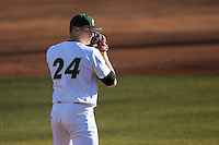 Charlotte 49ers starting pitcher Sean Geoghegan (24) looks to his catcher for the sign against the Rice Owls at Hayes Stadium on March 6, 2015 in Charlotte, North Carolina.  The Owls defeated the 49ers 4-2.  (Brian Westerholt/Four Seam Images)