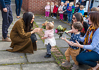 06/11/2019 - Meghan Markle Duchess of Sussex receiving a posy of flowers from Bonnie and Maggie Emanuel (mother and daughter), during a visit to Broom Farm Community Centre in Windsor. The Duke and Duchess of Sussex attended a coffee morning with families of deployed Army personnel at the Centre. Photo Credit: ALPR/AdMedia