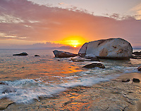 Virgin Gorda, British Virgin Islands, Caribbean <br /> Setting sun illuminates the beach at The Baths National Park .