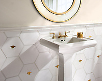 Napoleon and Bonaparte, a waterjet stone mosaic, shown in polished Calacatta, Thassos, and Gold Glass, is part of the Aurora® collection by Sara Baldwin for New Ravenna.