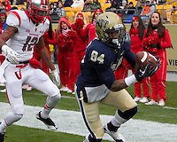 Pitt wide receiver Ed Tinker (84) makes a 13-yard touchdown catch behind Rutgers defensive back Marcus Cooper (12). The Pitt Panthers defeat the Rutgers Scarlet Knights 27-6 on Saturday, November 24, 2012 at Heinz Field , Pittsburgh, PA.