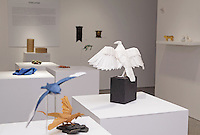 """Surface to Structure origami exhibition at Cooper Union, New York. Gallery view. Turkey Vulture """"Richard"""" designed and folded by Robert Lang 2011 (right). Tree Swallow designed and folded by Seth Friedman 2013 (left)."""