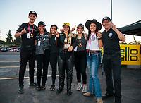 Nov 17, 2019; Pomona, CA, USA; NHRA pro stock motorcycle rider Jianna Salinas celebrates with her family after winning the Auto Club Finals at Auto Club Raceway at Pomona. Mandatory Credit: Mark J. Rebilas-USA TODAY Sports