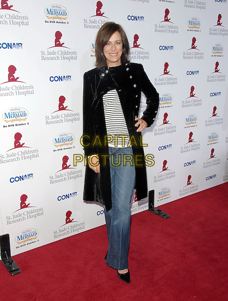 JANE KACZMAREK.Attends Runway for Life, Benefiting St. Jude Children's Research Hospital held at The Beverly Hilton Hotel in Beverly Hills, California, USA, September 15th 2006..full length black coat hand on hip.Ref: DVS.www.capitalpictures.com.sales@capitalpictures.com.©Debbie VanStory/Capital Pictures