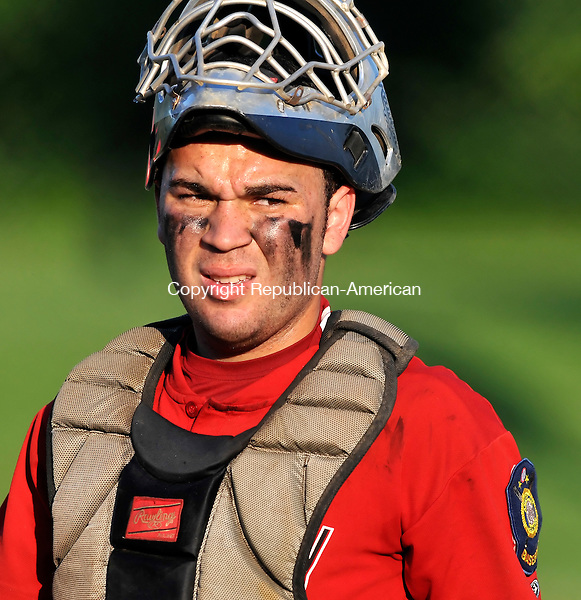WATERBURY, CT-06 JULY 2009-070609JS08-Waterbury Legion's catcher Christian Cuevas (14) looks to the bench for the next pitch to call during their game against Monroe Monday at Bucks Hill Park in Waterbury. <br /> Jim Shannon Republican-American