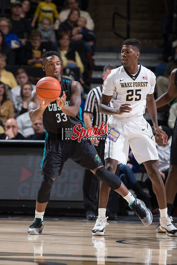 Ron Trapps (33) of the Coastal Carolina Chanticleers passes the ball during first half action against the Wake Forest Demon Deacons at the LJVM Coliseum on December 18, 2015 in Winston-Salem, North Carolina.  The Demon Deacons defeated the Chanticleers 83-77.  (Brian Westerholt/Sports On Film)