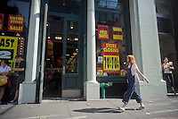 The Soho branch of Daffy's, the bargain department store, is seen in New York on Friday, September 14, 2012. The 51 year old chain has closed all of its 19 stores joining other discount chains such as Filene's Basement and Syms in discount heaven. The firm was founded by Irving Shulman in 1951 in New Jersey, originally named Daffy Dan's Bargain Town and sold off-price designer clothing.  (© Richard B. Levine)