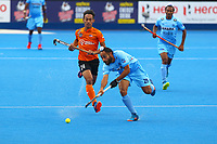Satbir Singh passes the ball during the Hockey World League Quarter-Final match between India and Malaysia at the Olympic Park, London, England on 22 June 2017. Photo by Steve McCarthy.