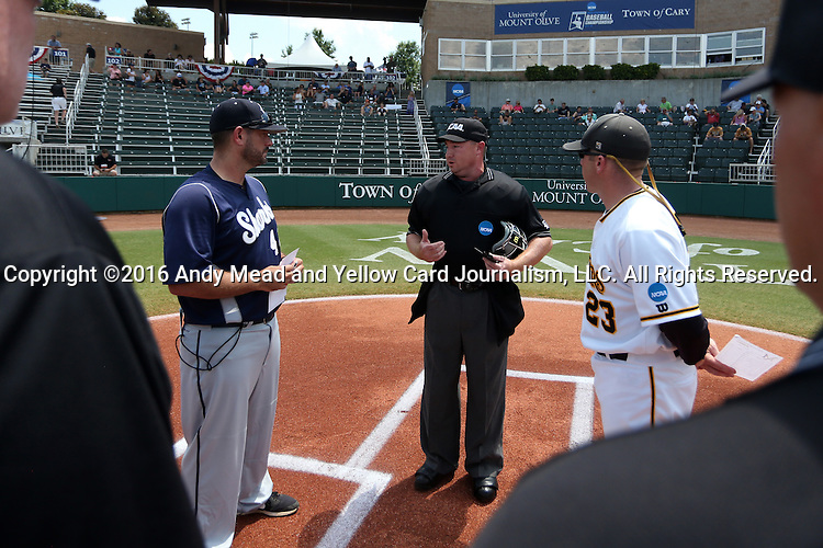 03 June 2016: Home plate umpire Brad Newton explains the ground rules to Nova Southeastern head coach Greg Brown (left) and Millersville head coach Jon Shehan (23). The Nova Southeastern University Sharks played the Millersville University Marauders in Game 13 of the 2016 NCAA Division II College World Series  at Coleman Field at the USA Baseball National Training Complex in Cary, North Carolina. Nova Southeastern won the first game of the best of three Championship Series 2-1.