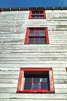 Windows on the side of the bunk house at Independence Mine State Historical Park, in the Hatcher Pass area about 50 miles north of Anchorage, Alaska.