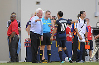 New York Red Bulls head coach Hans Backe talks with Landon Donovan (10) of the Los Angeles Galaxy. The Los Angeles Galaxy defeated the New York Red Bulls 1-0 during a Major League Soccer (MLS) match at Red Bull Arena in Harrison, NJ, on August 14, 2010.