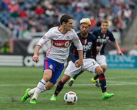 Foxborough, Massachusetts - April 9, 2016: First half action. In a Major League Soccer (MLS) match, the New England Revolution (blue/white) vs Toronto FC (white/blue), 1-0 (halftime), at Gillette Stadium.