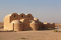Qasr Amra desert castle, Jordan. The original castle complex was built in 723-743 by Walid Ibn Yazid, the future Umayyad Caliph Walid II. It was a fortress with military garrison and residence of the Umayyad Caliphs. Today only the royal pleasure cabin remains, with reception hall and hammam or bath house, decorated with frescoes. The building is of limestone and basalt and has a triple-vaulted ceiling with smaller domed rooms. Qasr Amra is a UNESCO World Heritage Site. Picture by Manuel Cohen