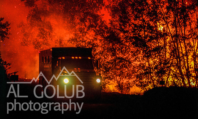 August 18, 1992 Angels Camp, California -- Old Gulch Fire— Fire trucks move along Sheep Ranch Road. The Old Gulch Fire raged over some 18,000 acres, destroying 42 homes while threatening the Mother Lode communities of Murphys, Sheep Ranch, Avery and Forest Meadows.