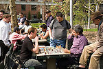 New York City, New York: Chess players in Washingston Square in Greenwich Village  .Photo #: ny309-15093  .Photo copyright Lee Foster, www.fostertravel.com, lee@fostertravel.com, 510-549-2202.