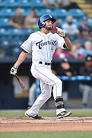 Asheville Tourists left fielder Max White (4) swings at a pitch during a game against the Kannapolis Intimidatorson May 19, 2015 in Asheville, North Carolina. The Tourists defeated the Intimidators 7-3. (Tony Farlow/Four Seam Images)
