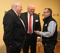 NWA Democrat-Gazette/ANDY SHUPE<br /> Hartzell Jones (from left), former deputy superintendent of Springdale Public Schools; speaks Thursday, Oct. 29, 2015, with Jim Rollins, superintendent of Springdale Public Schools; and Mike Luttrell, president of the Springdale School Board; before the start of the Springdale Public Schools Education Foundation Cornerstone Society induction ceremony at the Arts Center of the Ozarks in Springdale. Jones was honored during the ceremony. Visit nwadg.com/photos to see more photographs from the evening.