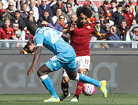 Calcio, Serie A: Roma vs Napoli. Roma, stadio Olimpico, 25 aprile 2016.<br /> Roma's Mohamed Salah, right, is challenged by Napoli's Kalidou Koulibaly during the Italian Serie A football match between Roma and Napoli at Rome's Olympic stadium, 25 April 2016.<br /> UPDATE IMAGES PRESS/Riccardo De Luca