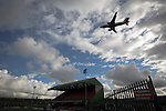 Glentoran 2 Cliftonville 1, 22/10/2016. The Oval, NIFL Premiership. An aircraft coming into land at the nearby George Best International Airport near The Oval, Belfast, pictured before Glentoran hosted city-rivals Cliftonville in an NIFL Premiership match. Glentoran, formed in 1892, have been based at The Oval since their formation and are historically one of Northern Ireland's 'big two' football clubs. They had an unprecendentally bad start to the 2016-17 league campaign, but came from behind to win this fixture 2-1, watched by a crowd of 1872. Photo by Colin McPherson.
