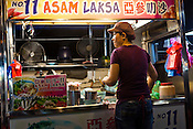 A vendor prepares Asam Laksa at the Chinese Hawker stall in Gurney Drive, Georgetown in Penang, Malaysia. Photo: Sanjit Das/Panos