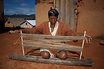 Sandrandahy, Madagascar. A traditional weaver prepares silk yarn to be dyed and woven.