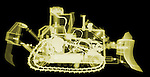 X-ray image of a bulldozer (yellow on black) by Jim Wehtje, specialist in x-ray art and design images.