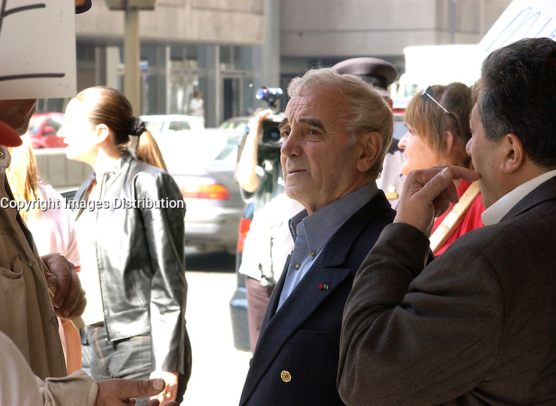 April 18 2002, Montreal, Quebec, Canada; <br /> French singer Charles Aznavour,walk among demonstrators as he leave the Queen Elizabeth hotel in downtown Montr&Egrave;al, April 18 2002<br /> <br /> <br /> <br /> <br /> <br /> <br /> <br /> (Mandatory Credit: Photo by Sevy - Images Distribution (&copy;) Copyright 2002 by Sevy<br /> <br /> NOTE :  D-1 H original JPEG, saved as Adobe 1998 RGB