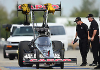 Sept. 30, 2012; Madison, IL, USA: NHRA crew members for top fuel dragster driver Steve Torrence during the Midwest Nationals at Gateway Motorsports Park. Mandatory Credit: Mark J. Rebilas-