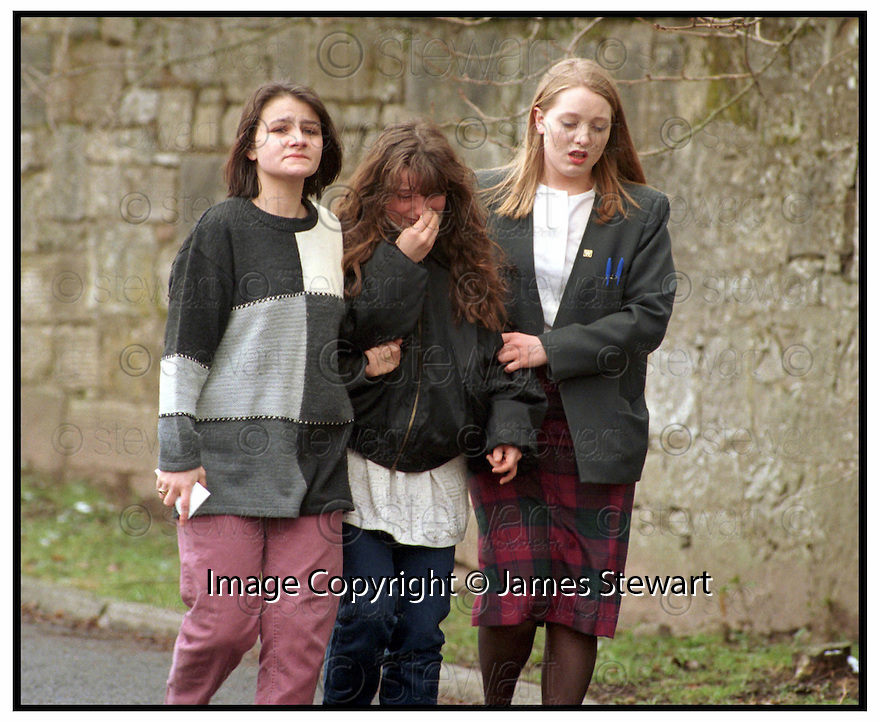 03/03/2006         Copyright Pic: James Stewart.File Name : sct_jspa10_DUNBLANE_anniversary.DUNBLANE 10TH ANNIVERSARY.UNIDENTIFIED RELATIVES OF PUPILS FROM DUNBLANE PRIMARY SCHOOL ARRIVE AT THE SCHOOL WHERE GUMAN THOMAS HAMILTON OPENED FIRE ON THE 13TH MARCH 1996 KILLING TEACHER GWEN MAYOR AND 16 SCHOOL CHILDREN.....Payments to :.James Stewart Photo Agency 19 Carronlea Drive, Falkirk. FK2 8DN      Vat Reg No. 607 6932 25.Office     : +44 (0)1324 570906     .Mobile   : +44 (0)7721 416997.Fax         : +44 (0)1324 570906.E-mail  :  jim@jspa.co.uk.If you require further information then contact Jim Stewart on any of the numbers above.........
