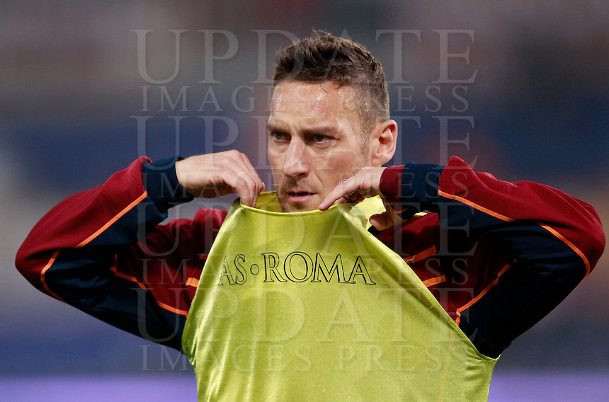 Calcio, Serie A: Roma vs Udinese. Roma, stadio Olimpico, 17 marzo 2014.<br /> AS Roma forward Francesco Totti warms up prior to the start of the Italian Serie A football match between AS Roma and Udinese at Rome's Olympic stadium, 17 March 2014.<br /> UPDATE IMAGES PRESS/Isabella Bonotto