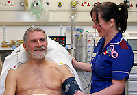 Nurse making patient comfortable in Accident & Emergency Department.