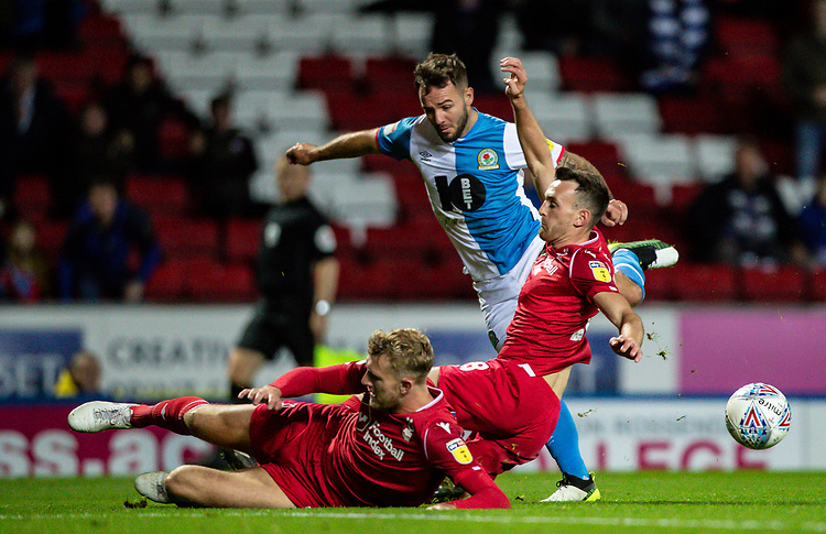 Blackburn Rovers' Adam Armstrong (centre) competing with Nottingham Forest's Jack Robinson (right) and Joe Worrall <br /> <br /> Photographer Andrew Kearns/CameraSport<br /> <br /> The EFL Sky Bet Championship - Blackburn Rovers v Nottingham Forest - Tuesday 1st October 2019  - Ewood Park - Blackburn<br /> <br /> World Copyright © 2019 CameraSport. All rights reserved. 43 Linden Ave. Countesthorpe. Leicester. England. LE8 5PG - Tel: +44 (0) 116 277 4147 - admin@camerasport.com - www.camerasport.com