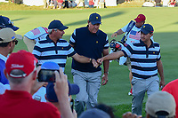 Kevin Kisner (USA) fist bumps Freddie Couples on the way to the 17th tee during round 1 foursomes of the 2017 President's Cup, Liberty National Golf Club, Jersey City, New Jersey, USA. 9/28/2017.<br /> Picture: Golffile   Ken Murray<br /> ll photo usage must carry mandatory copyright credit (&copy; Golffile   Ken Murray)